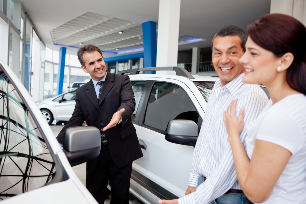 Couple at the dealership looking for a new car