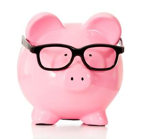 Geeky funky piggybank with glasses - isolated over a white background.jpeg