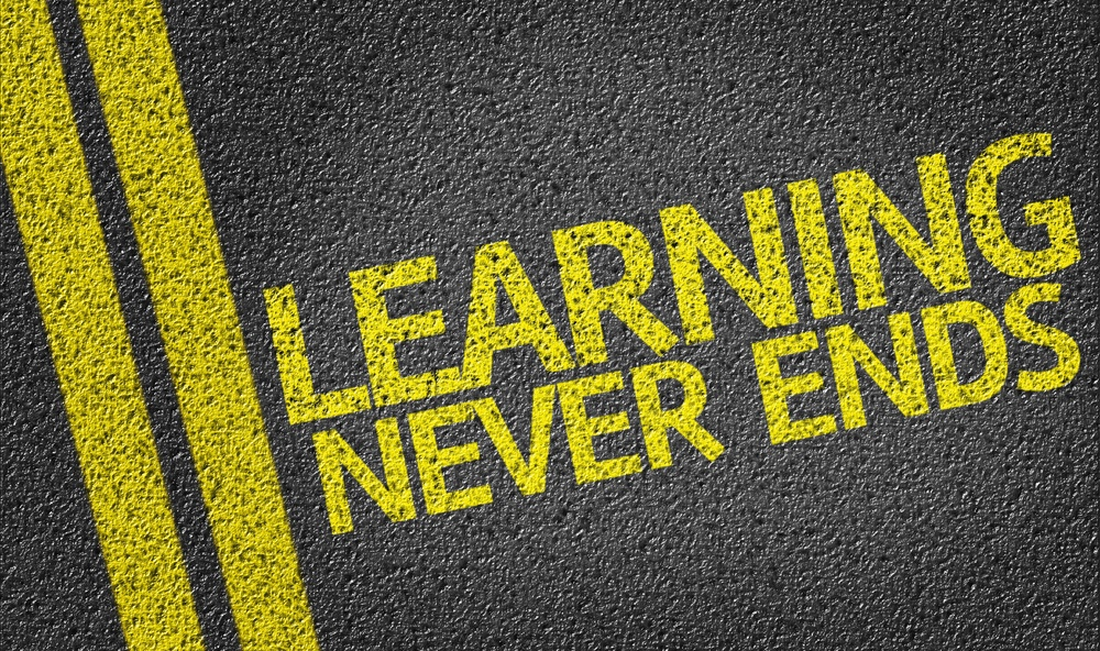Learning Never Ends written on the road.jpeg