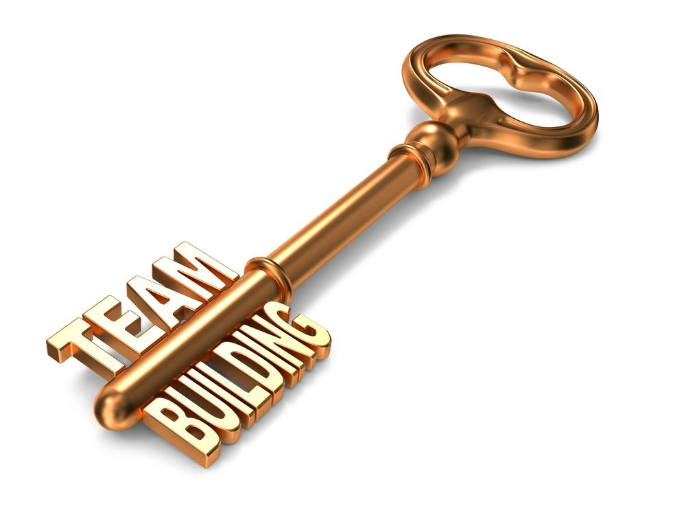 Team Bulding - Golden Key on White Background. 3D Render. Business Concept..jpeg