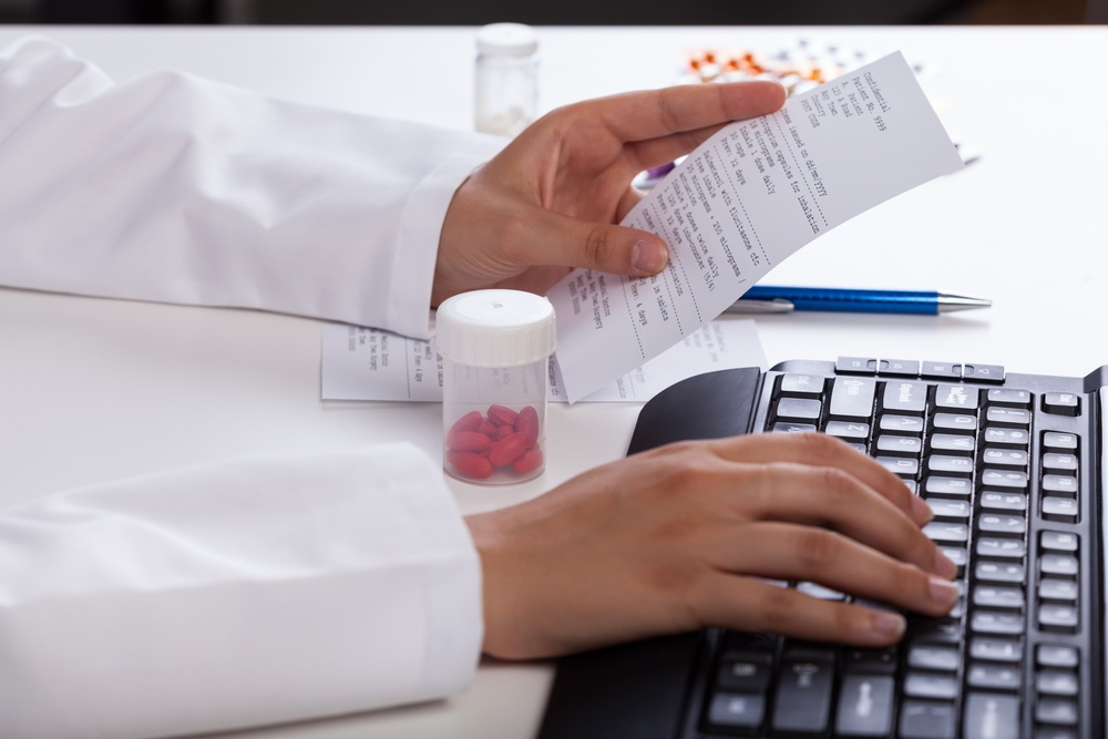 Pharmacist's hands checking information about medicines.jpeg